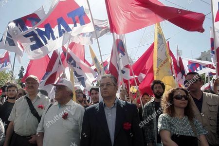 General Secretary of the Communist Party of Greece (kke) Dimitris Koutsoumpas (c) Stands Among Party Supporters During a Rally Marking May Day in Central Athens Greece 01 May 2013 Several Thousand Greek Workers Took to the Streets to Protest the Government's Austerity Measures As a 24-hour Nationwide Strike Disrupted Public Transport Across the Country Greece Athens