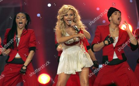 Stock Photo of Tina Karol Representing Ukraine Performs the Song : 'Show Me Your Love' During the Semi Finals of the 51st Eurovision Song Contest Hosted at Oaka's Olympic Indoor Hall in Athens Thursday 18 May 2006 Only 10 of the 23 Contestants in the Semi Finals Will Qualify For the Eurovision Final on 20 May Greece Athens