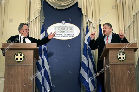 Newly Appointed Greek Foreign Minister Nikos Kotzias (l) Chats with Outgoing Foreign Minister Evangelos Venizelos (r) During the Handover Ceremony at the Foreign Ministry in Athens Greece on 27 January 2015 the Members of the New Greek Government Were Sworn in at Evening in the Presence of President of the Republic Karolos Papoulias and Prime Minister Alexis Tsipras It is the First Government in the Greek History Lead by a Leftist Premier Greece Athens