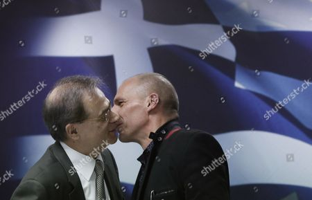 Outgoing Greek Finance Minister Gikas Hardouvelis (l) Kisses Newly Appointed Finance Minister Yanis Varoufakis (r) During the Handover Ceremony in the Ministry of Finance in Athens Greece 28 January 2015 the Members of the New Greek Government the First Government in the Greek History Lead by a Leftist Premier Were Sworn on 27 January 2015 Greece Athens