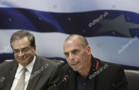 Outgoing Greek Finance Minister Gikas Hardouvelis (l) and Newly Appointed Finance Minister Yanis Varoufakis (r) Attend the Handover Ceremony in the Ministry of Finance in Athens Greece 28 January 2015 the Members of the New Greek Government the First Government in the Greek History Lead by a Leftist Premier Were Sworn on 27 January 2015 Greece Athens