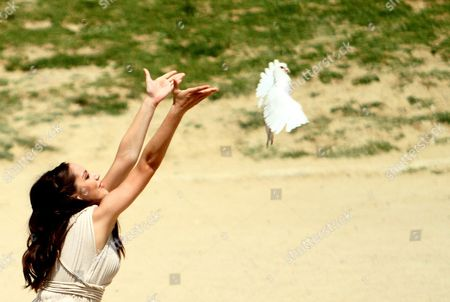 An Actress Playing the Role of a Priestess Releases a Dove in Front of the First Torchbearer During of the Lighting Ceremony of the Olympic Flame For London Summer Olympics 2012 in Ancient Olympia Greece 10 May 2012 the Flame was Handed Over to Spyros Gianniotis Before Making a 1 800-mile Journey Through the Country Using 490 Torchbearers It Will Then Be Handed to London Organizers on May 17 in Athens' Panathenaic Stadium where the First Modern Games Were Held in 1896 the London Games Will Be Held From July 27 Until August 12 Greece Olympia
