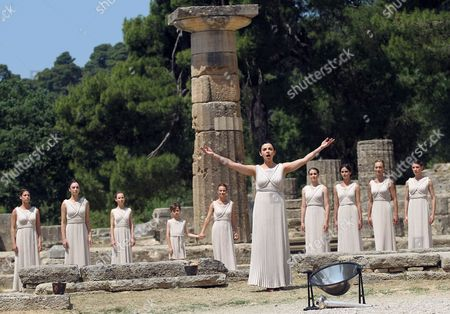 Stock Picture of Priestesses Perform During the Lighting Ceremony of the Olympic Flame For London Summer Olympics in Ancient Olympia Greece 10 May 2012 the Flame Will Be Handed Over to the First Torchbearer Greek World Champion Swimmer Spyros Gianniotis Before Making a 1 800-mile Journey Through the Country Using 490 Torchbearers It Will Then Be Handed to London Organizers on May 17 in Athens' Panathiaic Stadium where the First Modern Games Were Held in 1896 the London Games Will Be Held From July 27 Until August 12 Epa/orestis Panagiotou Greece Olympia