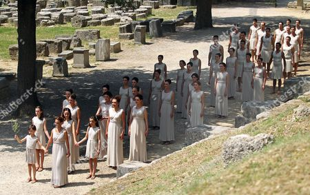 Actors Playing the Roles of Priestesses Carry a Pot with the Olympic Flame During the Lighting Ceremony of the Olympic Flame For London Summer Olympics 2012 in Front of Hera Temple in Ancient Olympia Greece 10 May 2012 the Flame Will Be Handed Over to the First Torchbearer Greek World Champion Swimmer Spyros Gianniotis Before Making a 1 800-mile Journey Through the Country Using 490 Torchbearers It Will Then Be Handed to London Organizers on May 17 in Athens' Panathiaic Stadium where the First Modern Games Were Held in 1896 the London Games Will Be Held From July 27 Until August 12 Greece Olympia