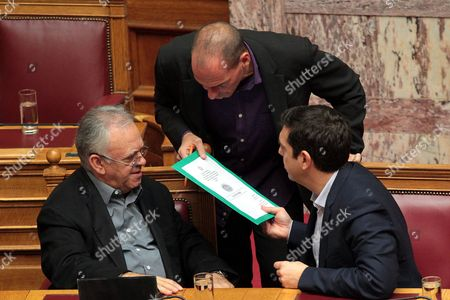 Greek Prime Minister Alexis Tsipras (r) Talks with Finance Minister Yanis Varoufakis (c) and Deputy Prime Minister of the Greek Government Yannis Dragasakis (l) in the Parliament During the Election of New President of the Greek Parliament in Athens Greece 06 February 2015 Syriza Mp Zoe Konstantopoulou was Elected President of Parliament After Receiving 235 Votes Konstantopoulou Born in 1976 is the Youngest Parliament President in the History of the House Greece Athens