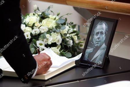 A Man Signs the Book of Condolences After the Fuenral Service of Cypriot Film Director Screenwriter and Producer Michael Cacoyannis (photo) at the Michael Cacoyannis Foundation in Athens Greece 28 July 2011 Michael Cacoyannis Died Aged 90 in an Athens Hospital on 25 July 2011 He was Nominated For an Academy Award Five Times Best Known For His 1964 Film 'Zorba the Greek' Greece Athens