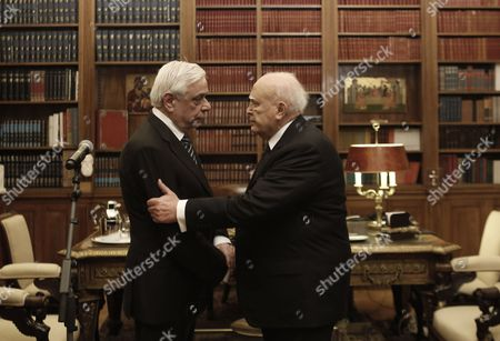 Outgoing Greek President Karolos Papoulias (r) Shakes Hands with Newly Elected President of the Republic Prokopis Pavlopoulos (l) During a Handover Ceremony in Athens Greece 13 March 2015 Prokopis Pavlopoulos was Sworn in As the New President of the Hellenic Republic During a Ceremony Held in the Greek Parliament Greece Athens