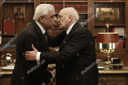Outgoing Greek President Karolos Papoulias (r) Kisses Newly Elected President of the Republic Prokopis Pavlopoulos (l) During a Handover Ceremony in Athens Greece 13 March 2015 Prokopis Pavlopoulos was Sworn in As the New President of the Hellenic Republic During a Ceremony Held in the Greek Parliament Greece Athens