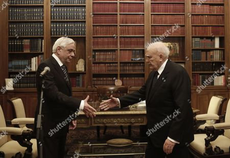 Outgoing Greek President Karolos Papoulias (r) Shakes Hands with Newly-elected President of the Republic Prokopis Pavlopoulos (l) During a Handover Ceremony in Athens Greece 13 March 2015 Prokopis Pavlopoulos was Sworn in As the New President of the Hellenic Republic During a Ceremony Held in the Greek Parliament Greece Athens