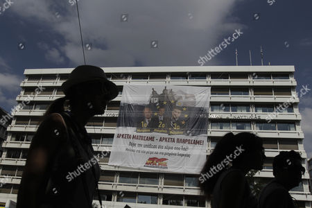 A Banner Placed by Protesters of the Communist-affiliated Trade Union Pame Hangs on the Building of Finance Ministry During an Anti-austerity and Anti-government Protest in Athens Greece 11 June 2015 the Banner Depicts Greek Premier Alexis Tsipras and the Former Prime Ministers Antonis Samaras and George Papandreou and Reads 'Enough Blood We Have Shed Enough We Have Paid ' the Greek Government is Requesting an Extension of the Current Loan Agreement by Nine Months to Ensure the Funding of the Greek Economy Government Sources in Brussels Said on 10 June 2015 Greece Athens
