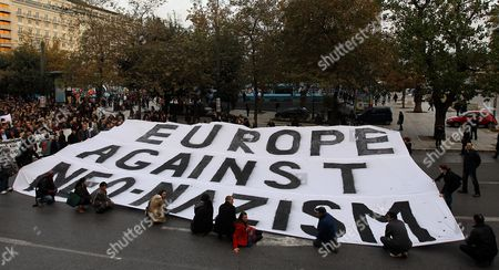 Migrants who Live in Athens and Antiracists From Greece and Countries of Europe Demonstrate Silently Holding a Huge Banner That Reads Europe Against Racism in Central Athens on 15 December 2012 Reports State That the Silent Walk From the Greek Parliament to the Foot of the Acropolis in Protest Against a Rising Surge of Racism Anti-semitism and Neo-nazism in Greek Society and Elsewhere in Europe was Proposed by the Paris-based 'European Grassroots Antiracist Movement' (egam) Last Monday It Has the Support of Activists From 20 Countries and is Backed by Scores of Civil Rights Groups Anti-racist Movements and Some High-profile Intellectuals Such As Nobel L Aureates Dario Fo and Bernard Kouchner and French Nazi-hunter Serge Klarsfeld with Greece Acting As a Gateway Into Europe For Large Numbers of Migrants From African and Asian Countries the Dramatic Influx of Foreigners Has Helped to Whip Up Anti-migrant Sentiment Among Ordinary Greeks and Catapulted Previously Marginal Far-right Extremist Groups Such As Golden Dawn Notorious For Their Attacks on Migrants to the Forefront of the Political Scene Greece Athens