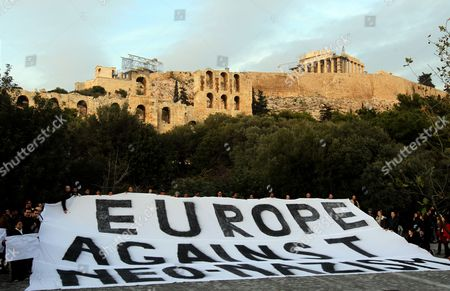 Migrants who Live in Athens and Antiracists From Greece and Countries of Europe Demonstrate Silently Holding a Huge Banner That Reads Europe Against Racism in Central Athens at the Foot of Acropolis Hill on 15 December 2012 Reports State That the Silent Walk From the Greek Parliament to the Foot of the Acropolis in Protest Against a Rising Surge of Racism Anti-semitism and Neo-nazism in Greek Society and Elsewhere in Europe was Proposed by the Paris-based 'European Grassroots Antiracist Movement' (egam) Last Monday It Has the Support of Activists From 20 Countries and is Backed by Scores of Civil Rights Groups Anti-racist Movements and Some High-profile Intellectuals Such As Nobel L Aureates Dario Fo and Bernard Kouchner and French Nazi-hunter Serge Klarsfeld with Greece Acting As a Gateway Into Europe For Large Numbers of Migrants From African and Asian Countries the Dramatic Influx of Foreigners Has Helped to Whip Up Anti-migrant Sentiment Among Ordinary Greeks and Catapulted Previously Marginal Far-right Extremist Groups Such As Golden Dawn Notorious For Their Attacks on Migrants to the Forefront of the Political Scene Greece Athens