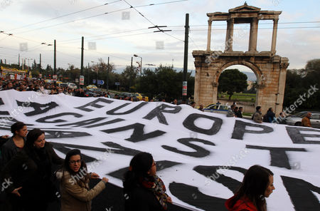 Migrants who Live in Athens and Antiracists From Greece and Countries of Europe Demonstrate Silently Holding a Huge Banner That Reads Europe Against Racism in Central Athens in Front of Adrian's Gate on 15 December 2012 Reports State That the Silent Walk From the Greek Parliament to the Foot of the Acropolis in Protest Against a Rising Surge of Racism Anti-semitism and Neo-nazism in Greek Society and Elsewhere in Europe was Proposed by the Paris-based 'European Grassroots Antiracist Movement' (egam) Last Monday It Has the Support of Activists From 20 Countries and is Backed by Scores of Civil Rights Groups Anti-racist Movements and Some High-profile Intellectuals Such As Nobel L Aureates Dario Fo and Bernard Kouchner and French Nazi-hunter Serge Klarsfeld with Greece Acting As a Gateway Into Europe For Large Numbers of Migrants From African and Asian Countries the Dramatic Influx of Foreigners Has Helped to Whip Up Anti-migrant Sentiment Among Ordinary Greeks and Catapulted Previously Marginal Far-right Extremist Groups Such As Golden Dawn Notorious For Their Attacks on Migrants to the Forefront of the Political Scene Greece Athens