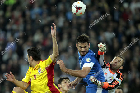 Stock Photo of Greece's Alexandros Tziolis (2 R) Vies For the Ball with Romania's Goalkeeper Ionut Bogdan Lobont (r) During the Fifa World Cup 2014 Qualifying Playoff First Leg Soccer Match Greece Vs Romania at the Karaiskakis Stadium of Piraeus Greece 15 November 2013 Greece Piraeus
