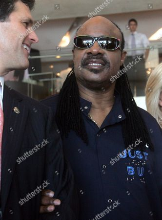 Stock Photo of The President of Special Olympics International Timothy Shriver-kennedy (l) and Us Singer Stevie Wonder (r) Chat During a Photo Session at the Press Conference Marking the Opening Ceremony of the Special Olympics Athens 2011 in Athens Greece 25 June 2011 Greece Athens