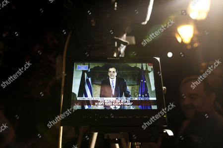 Greek Prime Minister Antonis Samaras is Seen on a Television Crew Screen As He Addresses the Nation After an Urgent Cabinet Meeting at the Prime Minister's Office in Athens Greece Early 21 June 2013 a Meeting Between the Three Party Leaders of the Coalition Government on the Shutting Down of State Broadcaster Ert and the Coalition Government's Function was Put on Pause with Pasok's Evangelos Venizelos and Dimar's Fotis Kouvelis Leaving the Government Building to Confer with Their Respective Parties' Parliamentary Group at Their Central Offices Samaras Called a Meeting of His New Democracy Party Ministers at His Office to Examine the Latest Developments Greece Athens