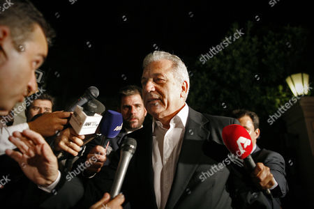 Greek Minister of Foreign Affairs Dimitris Avramopoulos (c) Addresses Journalists After an Urgent Cabinet Meeting at the Prime Minister's Office in Athens Greece Early 21 June 2013 a Meeting Between the Three Party Leaders of the Coalition Government on the Shutting Down of State Broadcaster Ert and the Coalition Government's Function was Put on Pause with Pasok's Evangelos Venizelos and Dimar's Fotis Kouvelis Leaving the Government Building to Confer with Their Respective Parties' Parliamentary Group at Their Central Offices Samaras Called a Meeting of His New Democracy Party Ministers at His Office to Examine the Latest Developments Greece Athens