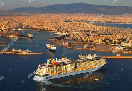 An Aerial View Shows the 347-meter Long Cruise Ship Quantum of the Seas (f) of Royal Carribean As It Enters the Port of Piraeus Near Athens Greece 18 May 2015 Speaking at the 19th Economist Roundtable in Athens on Friday Alternate Minister For Tourism Elena Kountoura Said That an Extension of the Tourist Season is Still the Target For Greece As Well As to Make the 'Top Five; For the World's Most Popular Destinations Greece Athens