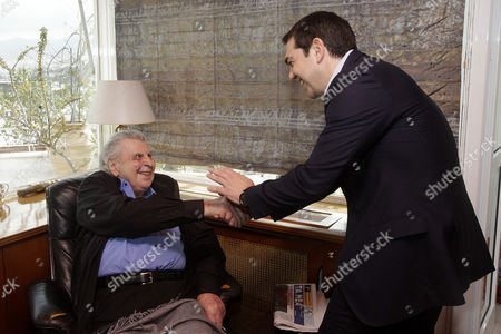 Greek Prime Minister Alexis Tsipras (r) is Welcomed by Legendary Greek Composer Mikis Theodorakis (l) in the Musician's House in Athens Greece 24 February 2015 During the Meeting Tsipras and Theodorakis Reportedly Discussed the Conclusion of the Negotiations Between the Greek Government and the Eurogroup in Brussels Greece's Syriza-led Government Has Submitted Its List of Reform Proposals the European Commission Said 24 February Adding That the Measures Are a 'Valid Starting Point' to Consider a Four-month Extension to the European Portion of the Country's Bailout Greece Athens