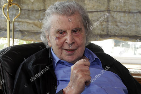 Legendary Greek Composer Mikis Theodorakis Chats with Greek Prime Minister Alexis Tsipras (unseen) in the Musician's House in Athens Greece 24 February 2015 During the Meeting Tsipras and Theodorakis Reportedly Discussed the Conclusion of the Negotiations Between the Greek Government and the Eurogroup in Brussels Greece's Syriza-led Government Has Submitted Its List of Reform Proposals the European Commission Said 24 February Adding That the Measures Are a 'Valid Starting Point' to Consider a Four-month Extension to the European Portion of the Country's Bailout Greece Athens