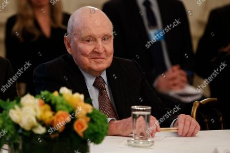 Former General Electric Chairman and CEO Jack Welch listens during a meeting between President Donald Trump and business leaders in the State Dining Room of the White House in Washington