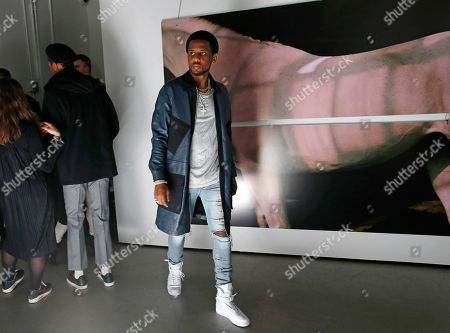 Hip Hop artist and Mens' Fashion week ambassador Fabolous walks into the Tim Coppens' capsule collection and book launch during Men's Fashion Week, in New York