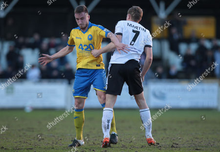 Stock Picture of Sam Chaney of Torquay United holds of Dave Martin of Bromley