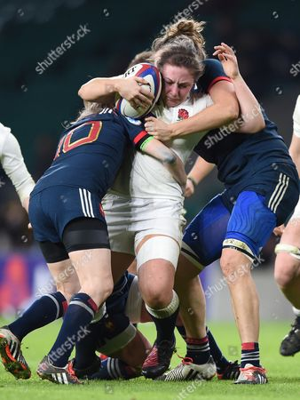 Amy Cokayne of England held by Christelle Le Duff of France  and Lenaig Corson of France  during the RBS 6 Nations match, between England and France Women at Twickenham Stadium, London , UK, on the 4th February 2017.