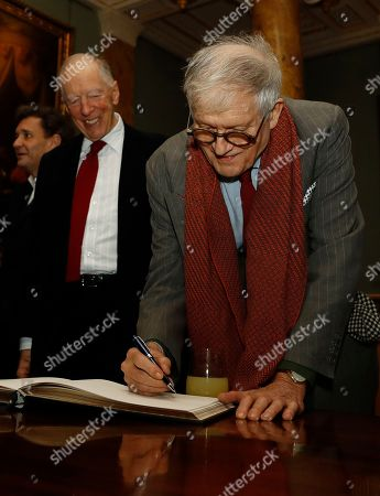 Artist David Hockney signs a guest book, viewed by Jacob Rothschild, 4th Baron Rothschild, after unveiling the bottle design for the 2014 vintage wine of Château Mouton Rothschild in London, . The commission for the illustration of the 2014 vintage was given to the English painter, a master of the most up-to-date techniques