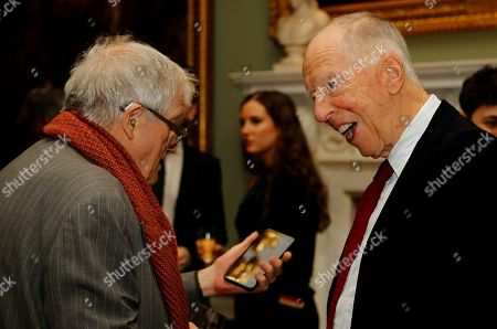 Stock Photo of Artist David Hockney and Jacob Rothschild, 4th Baron Rothschild, chat prior to the unveiling of the bottle design for the 2014 vintage wine of Château Mouton Rothschild in London, . The commission for the illustration of the 2014 vintage was given to the English painter, a master of the most up-to-date techniques
