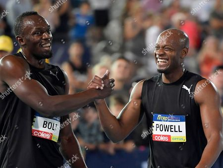Jamaica's Usain Bolt, left, and teammate Asafa Powell celebrate after winning the mixed 4 x 100 meter relay at the Nitro Athletics meet in Melbourne, Australia