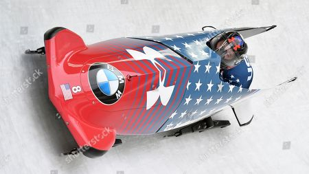 Steven Holcomb and Samuel McGuffie of the United States speed down the track during the first run of the men's two-man bobsled World Cup race in Igls, near Innsbruck, Austria