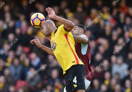 Younes Kaboul of Watford and Andre Gray of Burnley during the Premier League match between Watford and Burnley played at Vicarage Road, Watford on 4th February 2017