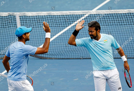 Stock Picture of India's Leander Paes, right, and Vishnu Vardhan celebrate a point against New Zealand's Artem Sitak and Michael Venus during their Davis Cup tennis Asia/Oceania Group I tie in Pune, India