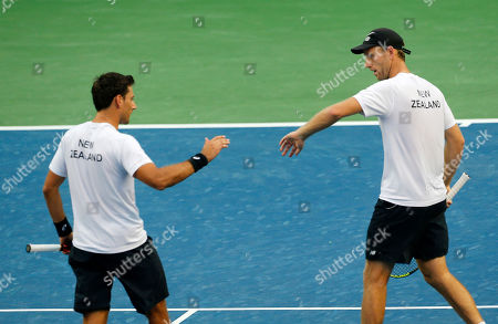 New Zealand's Artem Sitak, left, and Michael Venus celebrate a point against India's Leander Paes and Vishnu Vardhan during their Davis Cup tennis Asia/Oceania Group I tie in Pune, India