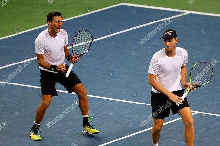 New Zealand's Artem Sitak, left and Michael Venus celebrate a point against India's Leander Paes and Vishnu Vardhan during their Davis Cup tennis Asia/Oceania Group I tie in Pune, India