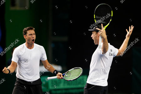 New Zealand's Artem Sitak, left, and Michael Venus celebrate winning their match against India's Leander Paes and Vishnu Vardhan during their Davis Cup tennis Asia/Oceania Group I tie in Pune, India