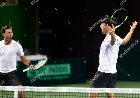 New Zealand's Artem Sitak, left, and Michael Venus celebrate their victory against India's Leander Paes and Vishnu Vardhan during their Davis Cup tennis Asia/Oceania Group I tie in Pune, India