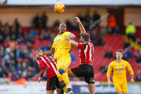 AFC Wimbledon forward Tom Elliott (9)  challenges Sheffield United defender Jack O?Connell (5)  during the EFL Sky Bet League 1 match between Sheffield Utd and AFC Wimbledon at Bramall Lane, Sheffield