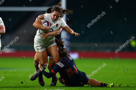 Amy Cokayne of England Women is tackled by Elodie Guiglion of France Women during the women's RBS 6 Nations match between England and France played at Twickenham Stadium, London on 4th February 2017