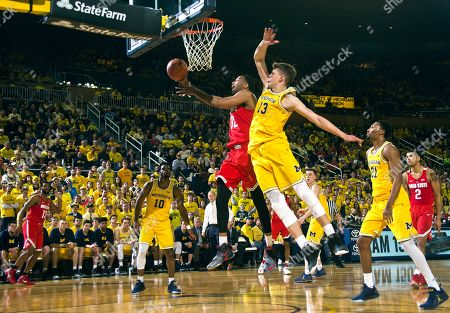 Trevor Thompson, Moritz Wagner Ohio State center Trevor Thompson (32) goes to the basket, defended by Michigan forward Moritz Wagner (13), of Germany, in the first half of an NCAA college basketball game at Crisler Center in Ann Arbor, Mich