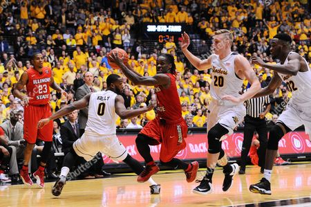 Illinois State Redbirds guard Paris Lee (1) finds an opening between Wichita State Shockers forward Rashard Kelly (0) and Wichita State Shockers center Rauno Nurger (20) on a drive to the basket during the NCAA Basketball Game between the Illinois State Redbirds and the Wichita State Shockers at Charles Koch Arena in Wichita,Kansas