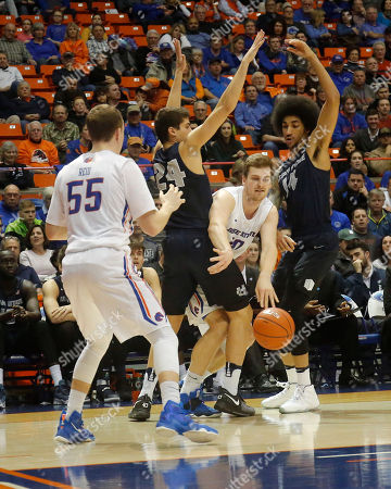 Robin Jorch, James Reid, Diogo Brito, Jalen Moore Boise State's Robin Jorch passes to James Reid (55) between Utah State's Diogo Brito (24) and Jalen Moore (14) during the second half of an NCAA college basketball game in Boise, Idaho, . Boise State won 72-70