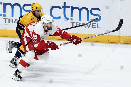 Riley Sheahan, Yannick Weber Detroit Red Wings center Riley Sheahan (15) and Nashville Predators defenseman Yannick Weber (7), of Switzerland, chase the puck during the second period of an NHL hockey game, in Nashville, Tenn