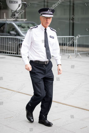 Metropolitan Police Commissioner Sir Bernard Hogan-Howe leaving