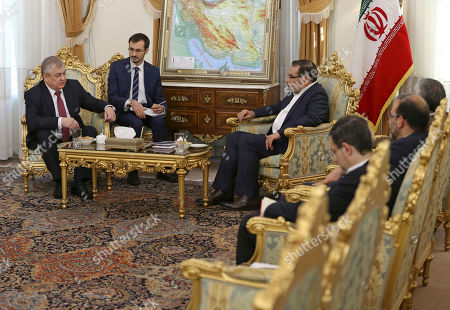 Ali Shamkhani, Alexander Lavrentiev Russia's special envoy on Syria Alexander Lavrentiev, left, talks with Secretary of Iran's Supreme National Security Council Ali Shamkhani, center right, during their meeting in Tehran, Iran, . An unidentified interpreter takes note at center