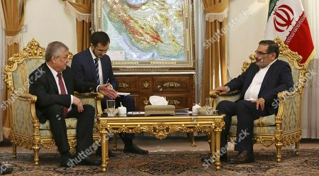 Ali Shamkhani, Alexander Lavrentiev Russia's special envoy on Syria Alexander Lavrentiev, left, talks with Secretary of Iran's Supreme National Security Council Ali Shamkhani, right, during their meeting in Tehran, Iran, . An unidentified interpreter takes note at center