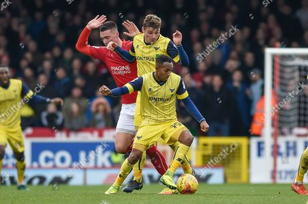 Oxford United Forward, Robert Hall (19) first to the ball during the EFL Sky Bet League 1 match between Swindon Town and Oxford United at the County Ground, Swindon