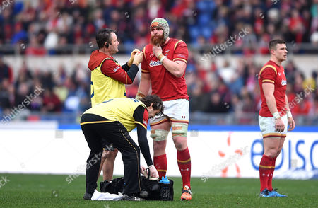 Jake Ball of Wales is treated by Dr Geoff Davies and physio Mark Davies.