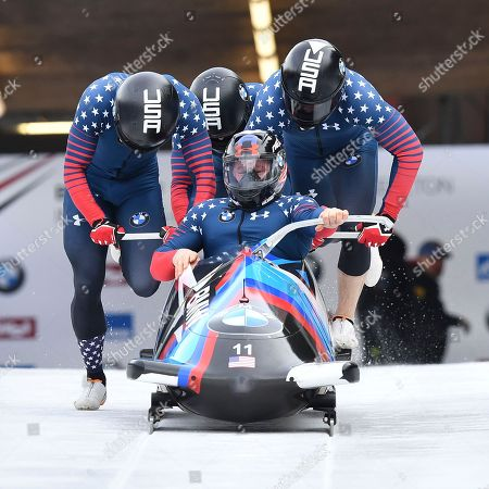 Pilot Steven Holcomb, front, and his pushers Carlo Valdes, James Reed and Samuel McGuffie from the United States start their first run of the four-man bob race at the bob World Cup in Igls, near Innsbruck, Austria